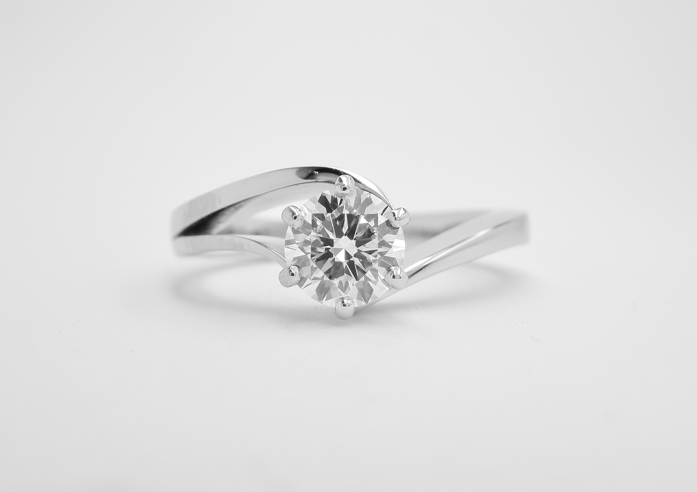 0.50ct. round brilliant cut diamond open shouldered wishbone cross-over ring. Ideal diamond sizes from 0.35ct. to 1.50ct.