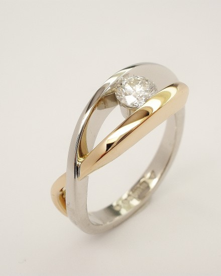 Platinum and 18ct. red gold ( rose gold, pink gold ) open cross-over single stone 0.37ct. round brilliant cut diamond ring. Ideal diamond sizes from 0.35cts. to 0.60cts.