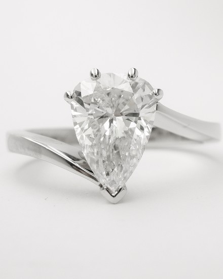 Pear shaped diamond of 1.10cts. mounted in a platinum cross-over ring mount.
