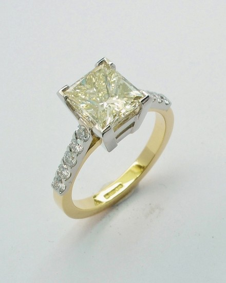 Champagne coloured Princess cut 2.01ct. diamond ring mounted in 18ct. yellow gold & platinum with 'D' coloured round brilliant cut diamonds in shoulders. Ideal diamond sizes 0.50ct to 4.00ct.