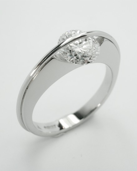 Platinum single stone 1.07ct. 'F' colour round brilliant cut diamond 'Lunar' style ring. Ideal diamond sizes from 0.50ct. to 1.25ct.