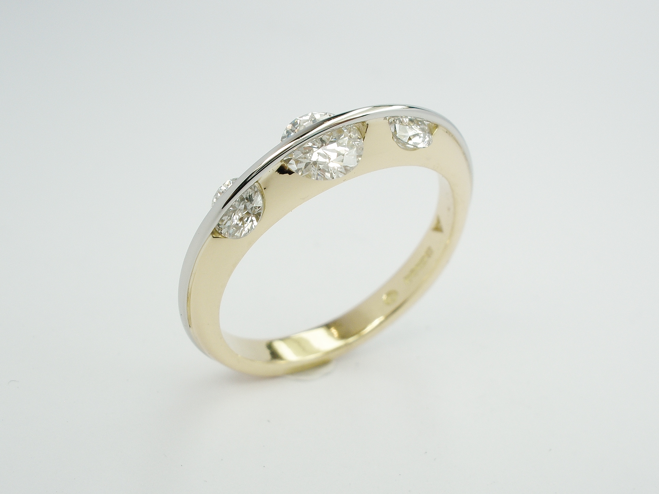 3 stone round brilliant cut 'D' colour diamond 'Lunar' ring mounted in 18ct. yellow gold and platinum. Ideal size of centre diamond 0.45ct to 0.75ct.