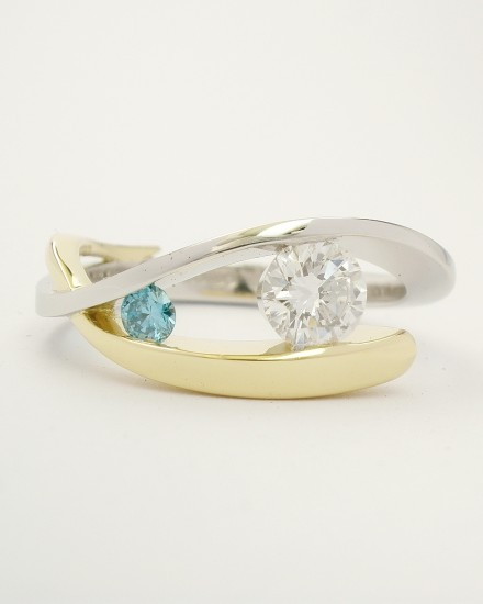 Platinum & 18ct. yellow gold open cross-over 2 stone white & sky blue round brilliant cut diamond ring. Ideal main diamond sizes from 0.35cts. to 0.60cts. & sky blue diamond in proportion.