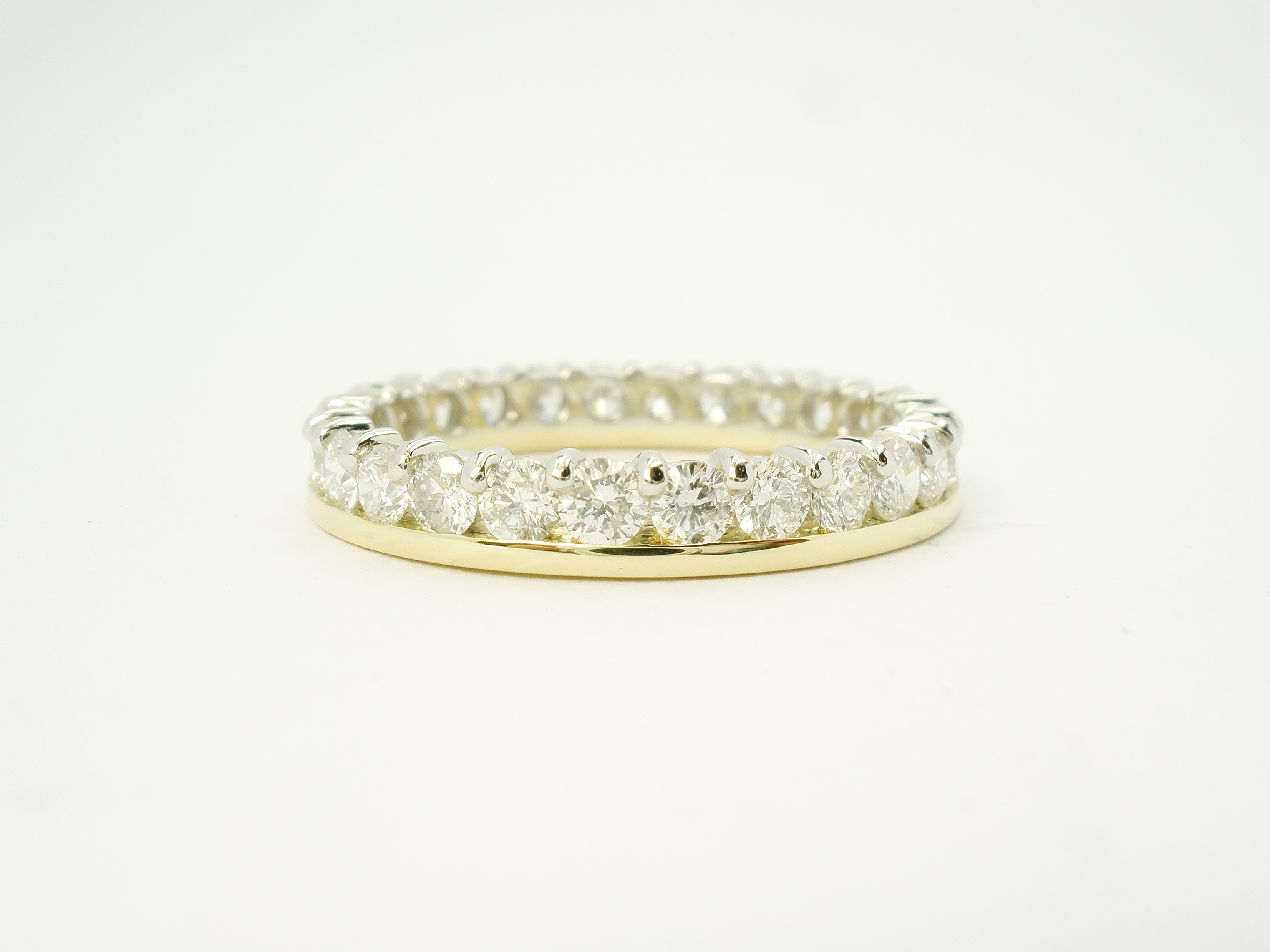 18ct. yellow gold & platinum part channel set diamond full hoop eternity ring.