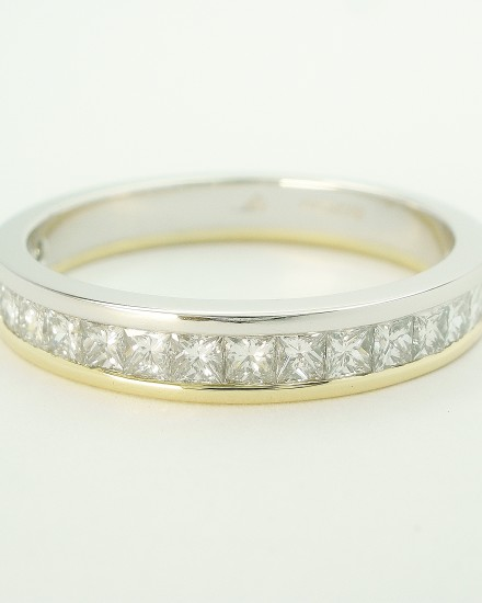 Princess cut diamond platinum & 18ct. yellow gold channel set wedding ring to 55% cover.
