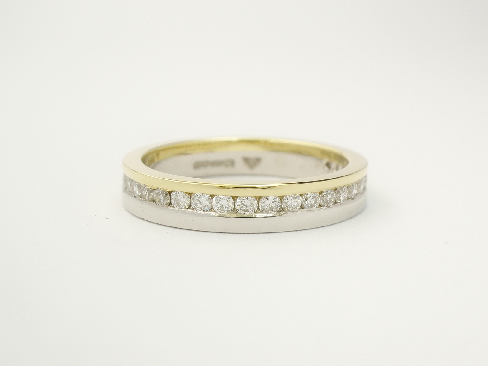 18ct. yellow gold & platinum off-set brilliant cut diamond wedding ring.