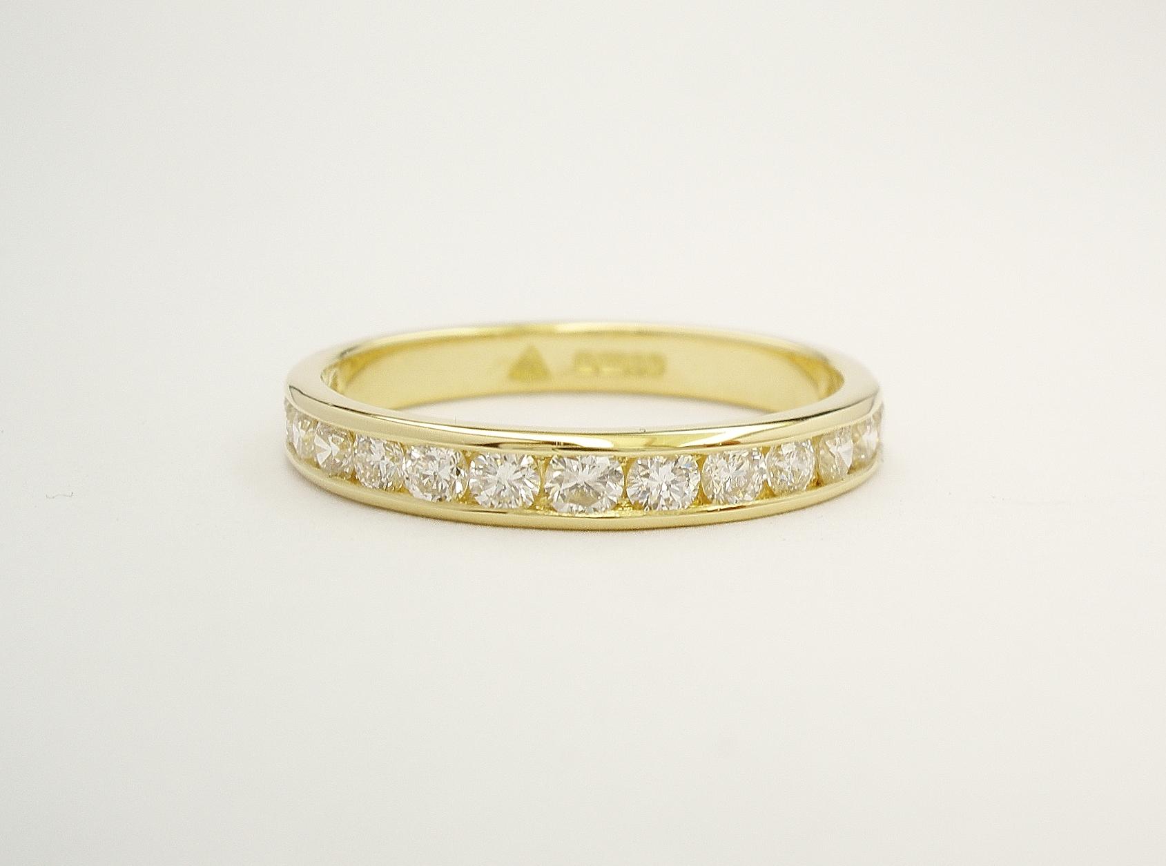 Platinum & channel set round brilliant cut diamond wedding ring set to 55% cover.