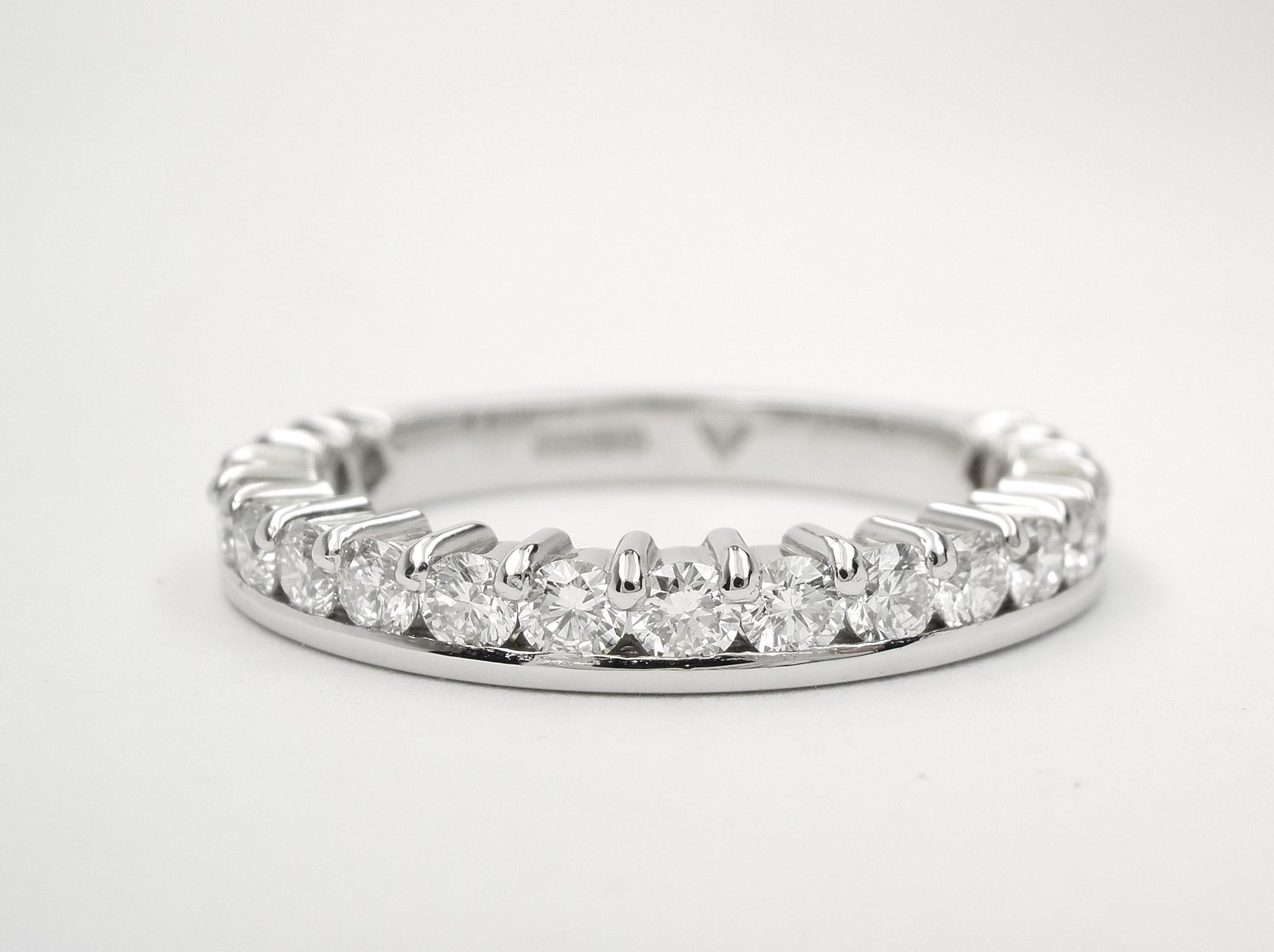 Platinum part channel set round brilliant cut diamond wedding ring set to 65%.