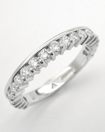 Platinum part channel set round brilliant cut diamond wedding ring set to 65%.