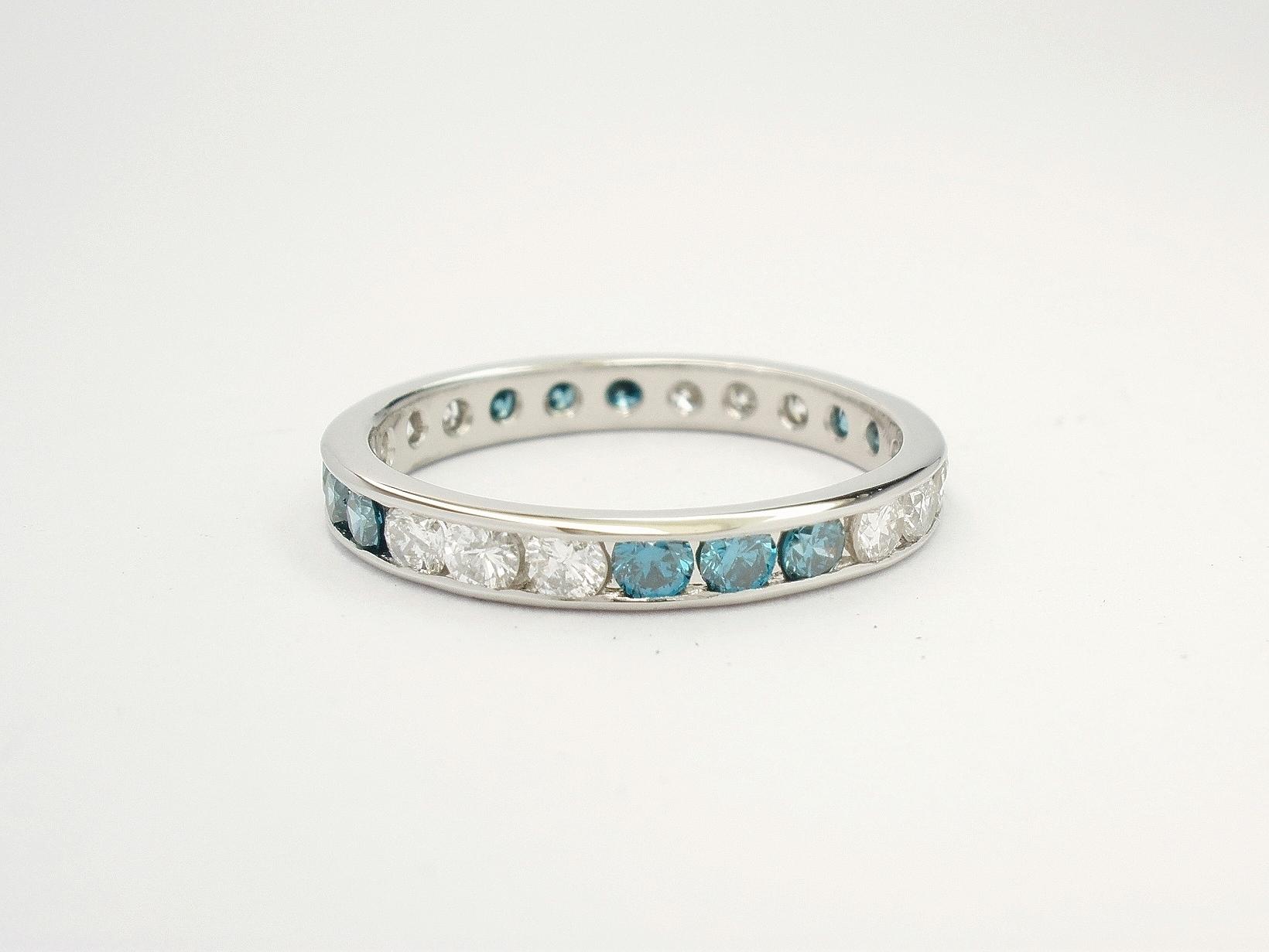 Ocean blue diamond & white diamond full channel set platinum eternity ring.