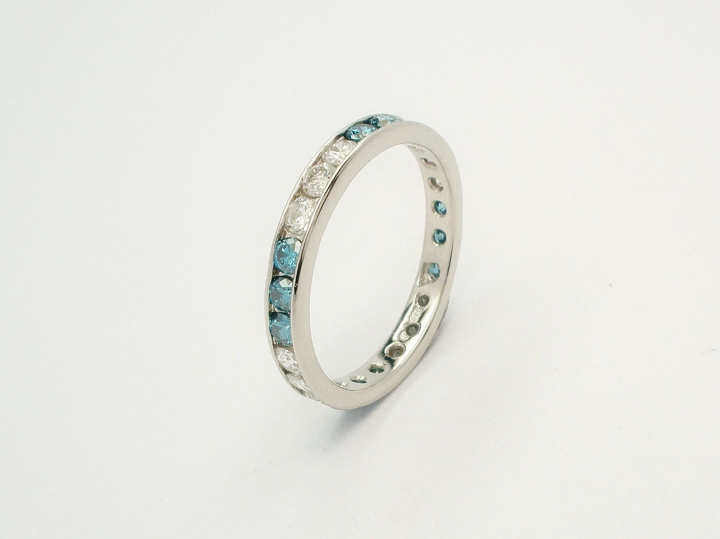 Ocean blue diamond & white diamond full channel set platinum eternity ring.