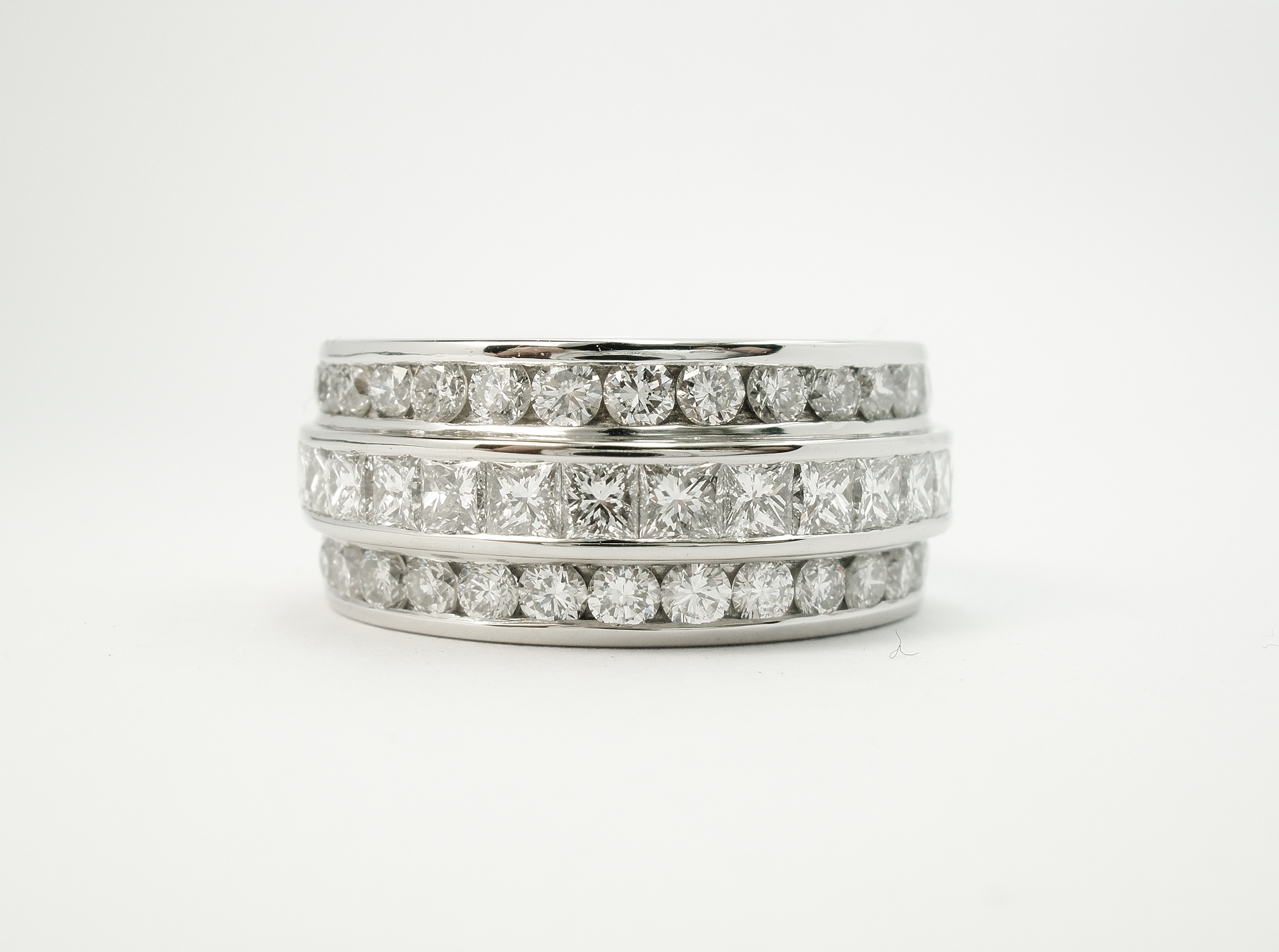 Princess cut diamond and round brilliant cut diamond triple platinum wedding ring set to 55% cover.