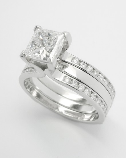 Single stone 1.19ct.'D' colour princess cut diamond 'Embrace' ring set in platinum. The twin shank allows for the insertion of a plain platinum wedding ring.