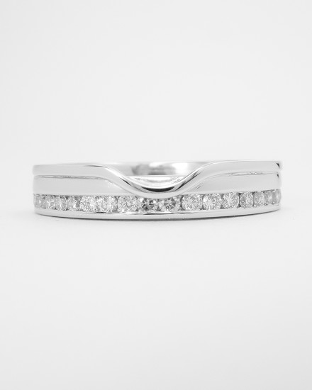 18ct. white gold 'Off-set' diamond wedding ring shaped to fit with a single stone straight diamond engagement ring.