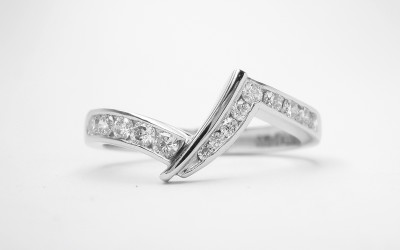 Platinum Zig Zag Wedding Ring Shaped To Fit A Pear Cross Over Engagement