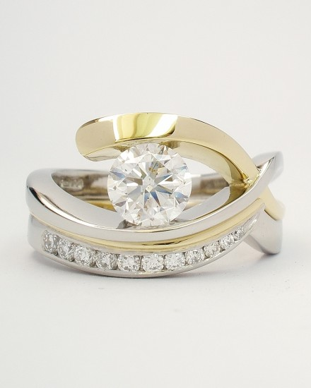 18ct. yellow gold & platinum wedding ring set with tapering sized diamonds around the curve shaped to fit single stone open cross-over engagement ring.