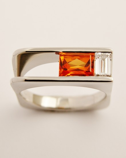 Orange sapphire baguette & baguette cut diamond channel set in a plateau, square sectioned, palladium ring.