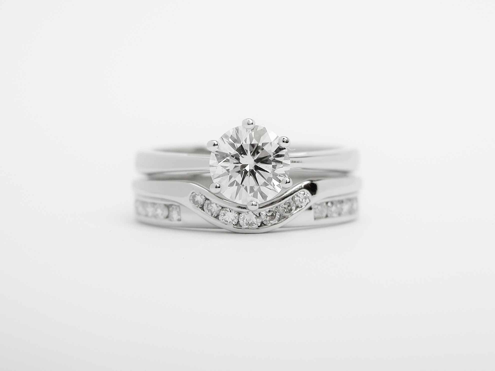 'Collar style' diamond set platinum wedding ring shaped to fit with a single stone straight diamond engagement ring.