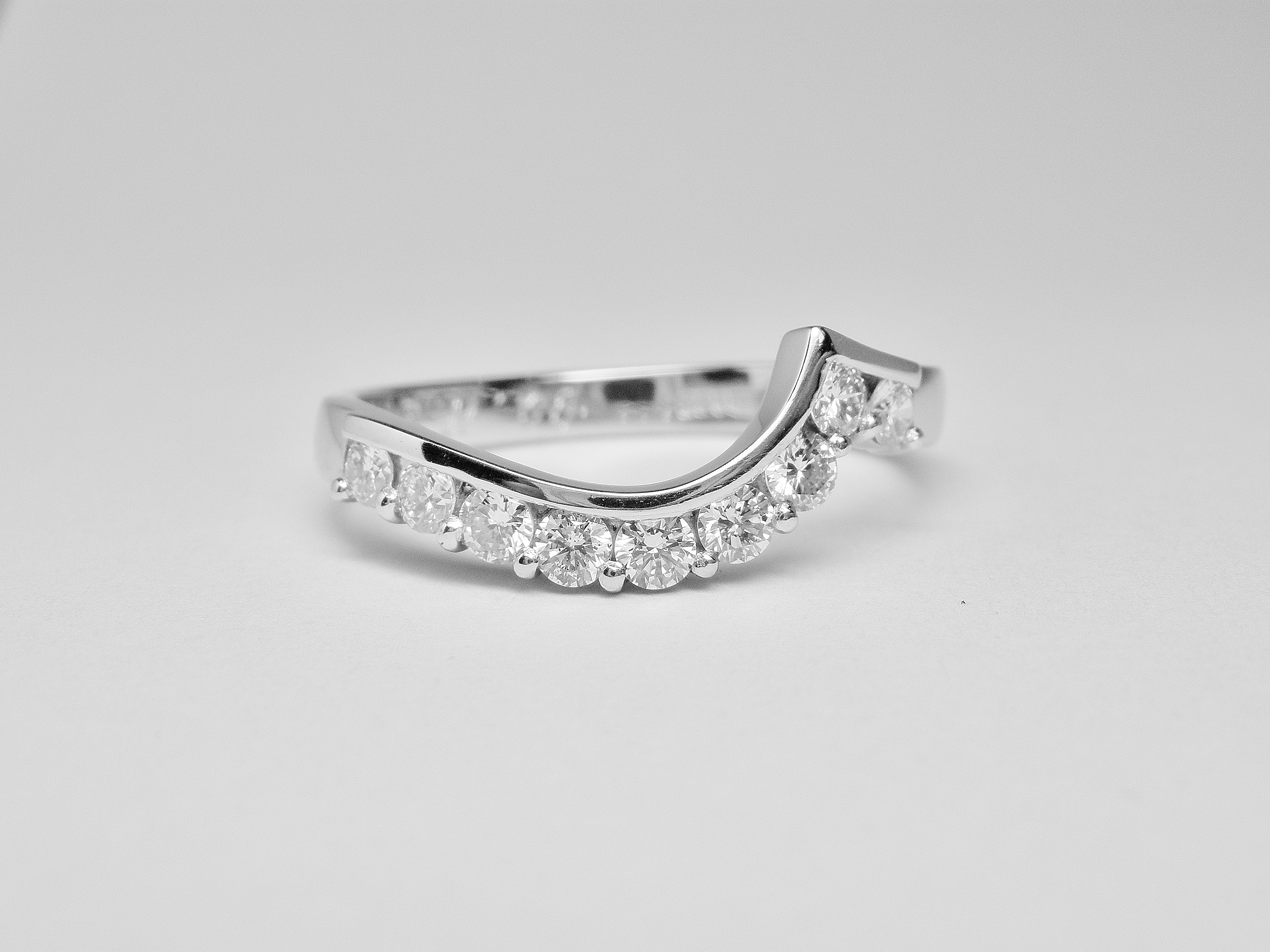 Part channel & wire set diamond wedding ring mounted in platinum & shaped to fit a single stone cross-over diamond engagement ring.