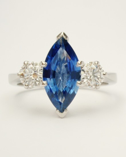 Marquise sapphire & round brilliant cut diamond 3 stone ring mounted in palladium & platinum.