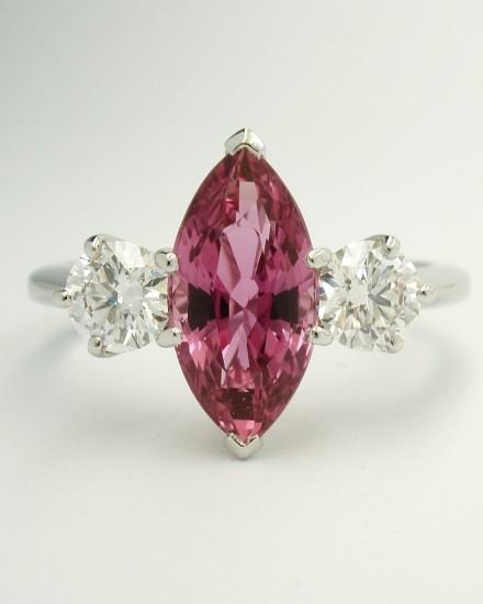 Marquise sapphire & round brilliant cut diamond 3 stone ring mounted in palladium & platinum.