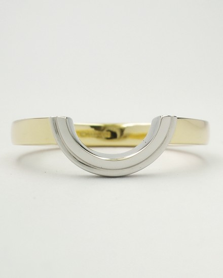 'Arc' shaped wedding ring created in 18ct. yellow gold and platinum to fit around a round diamond cluster engagement ring.