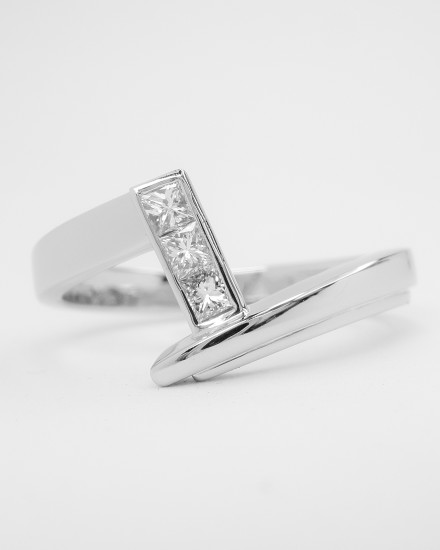 Zig-zag' platinum wedding ring shaped to fit a princess cut diamond cross-over engagement ring set with 3 princess cut diamonds.
