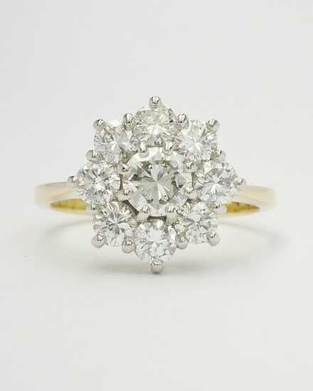 My remodel of 9 stone round brilliant cut diamond cluster in 18ct. yellow gold & platinum.