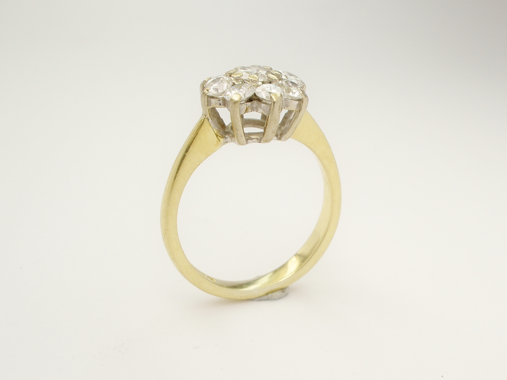 Customer's original 18ct. yellow & white gold 9 stone diamond cluster ring.