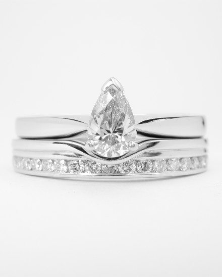 18ct. white gold wedding ring with applied wire shaped to fit a single stone pear diamond engagement ring with diamonds off-set along back edge.