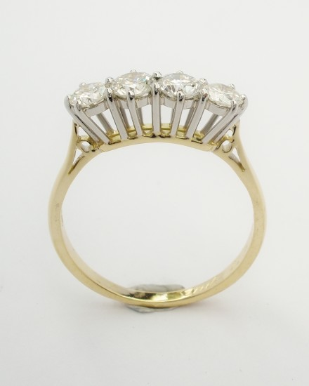 My remodel of 4 stone diamond ring peg set in platinum & 18ct. yellow gold.