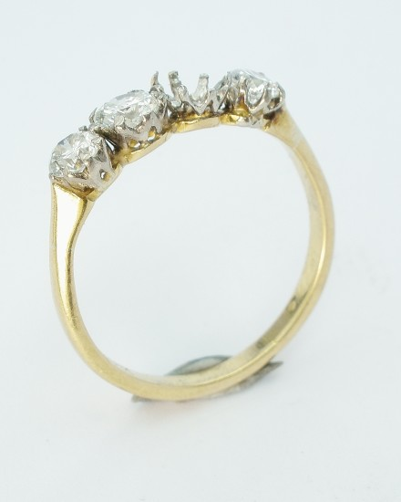 Worn 4 stone diamond ring to have diamond replaced and remounted in a similar style.