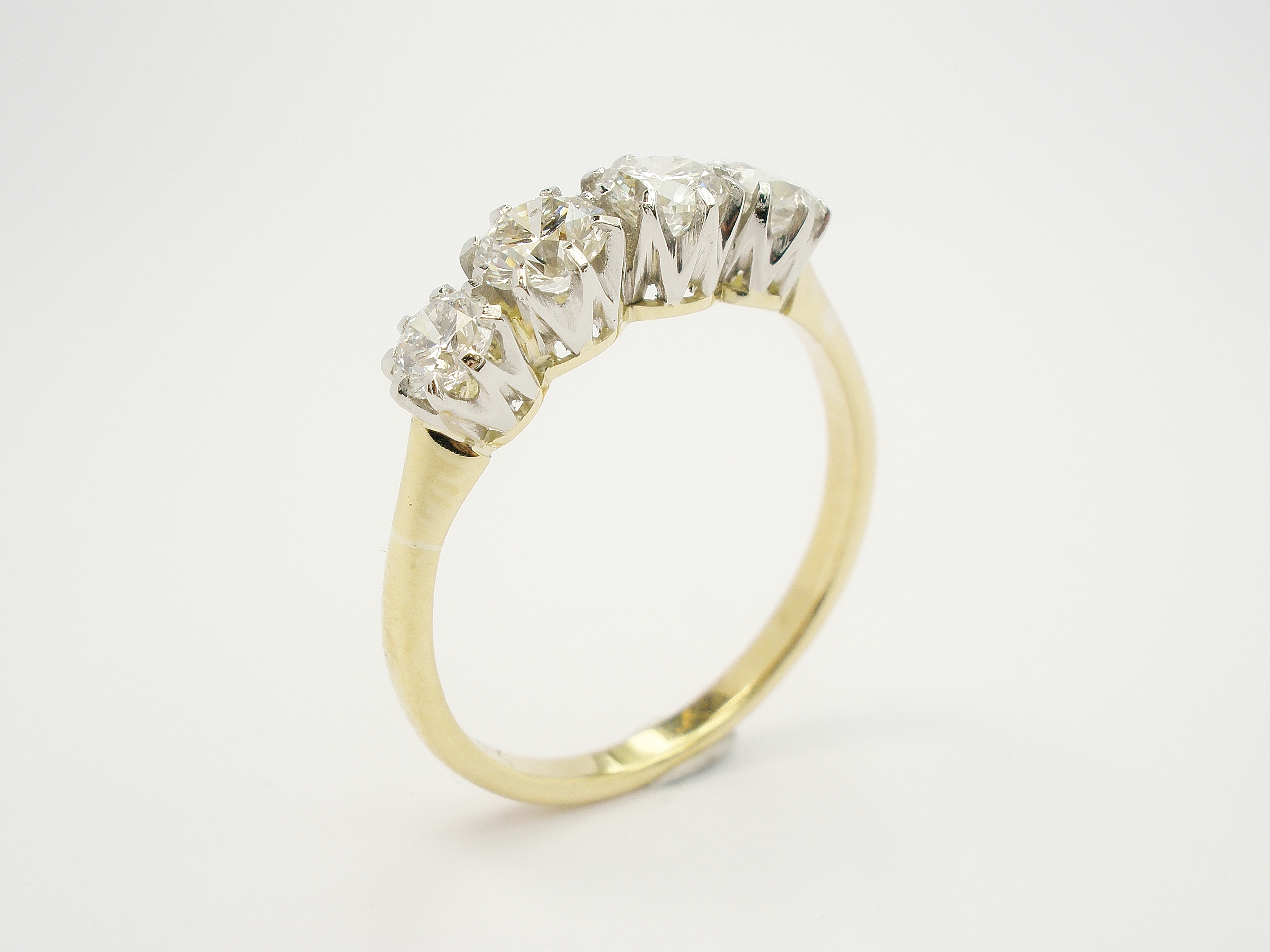 My remake of the 4 stone round brilliant cut diamond ring.