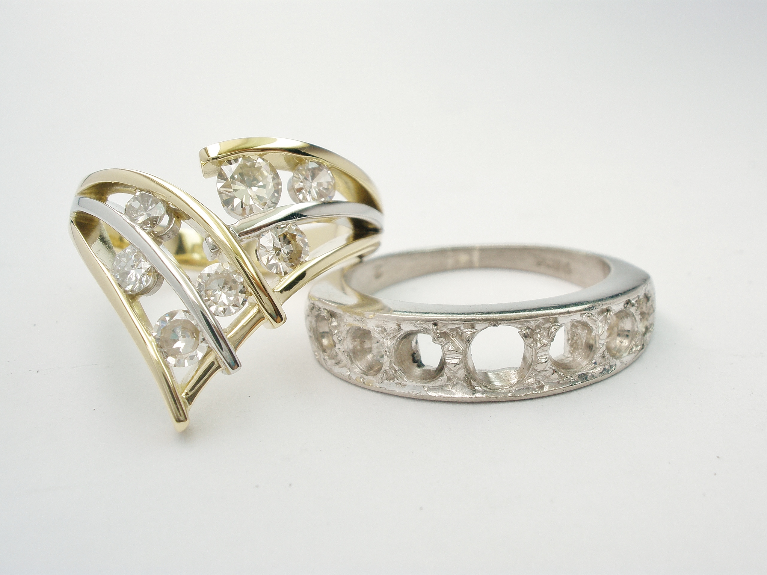 18ct. yellow gold & platinum 7 stone diamond wishbone style ring remodelled from original 7 stone bead set eternity ring.