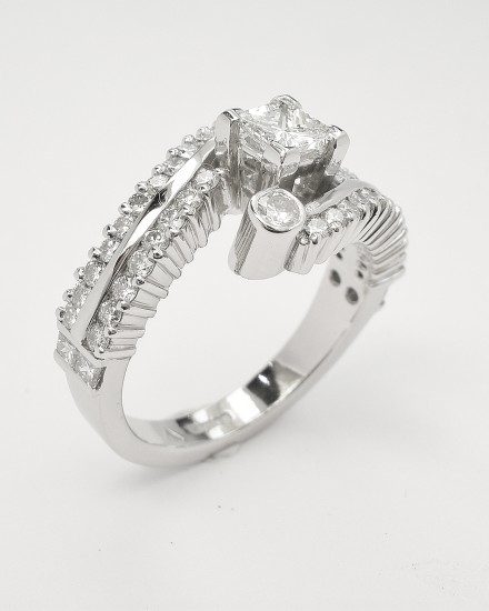 My palladium remodel of princess & brilliant cut diamond ring styled slightly different to make diamonds more secure.