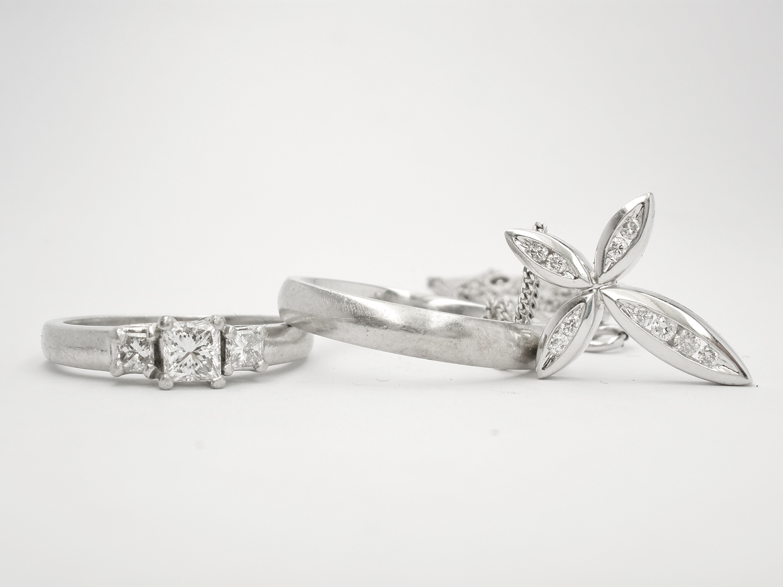 3 stone diamond princess cut ring, diamond set cross & plain platinum wedding ring to remount using platinum wedding ring into 1 ring.