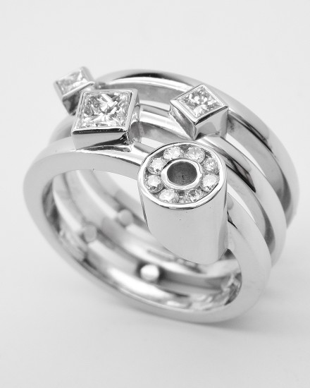 Diamonds remodelled into a triple banded ring, palladium outer rings with the plain platinum wedding ring in the centre & the diamonds rub-over set in platinum.