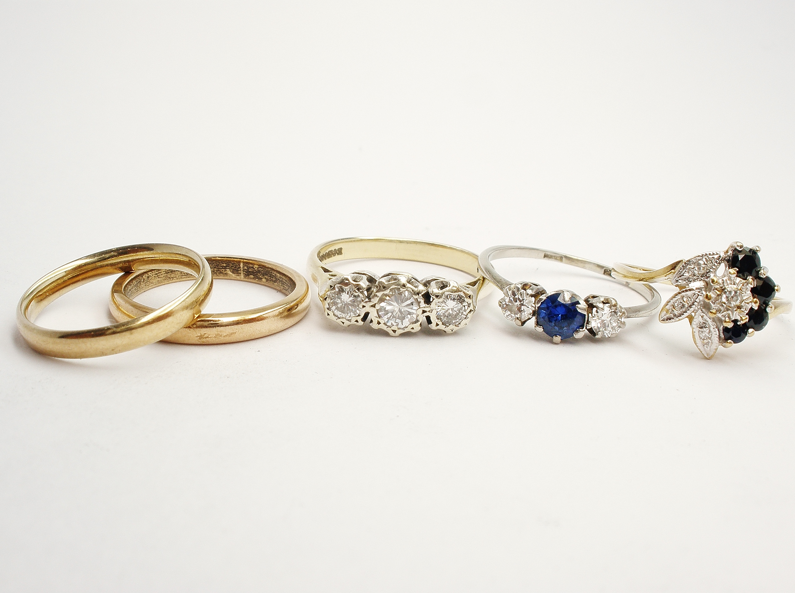 Items supplied. Clients mother's 3 stone diamond engagement ring & 3 stone sapphire and diamond ring, both her grandmothers' wedding rings, and her own diamond dress ring.
