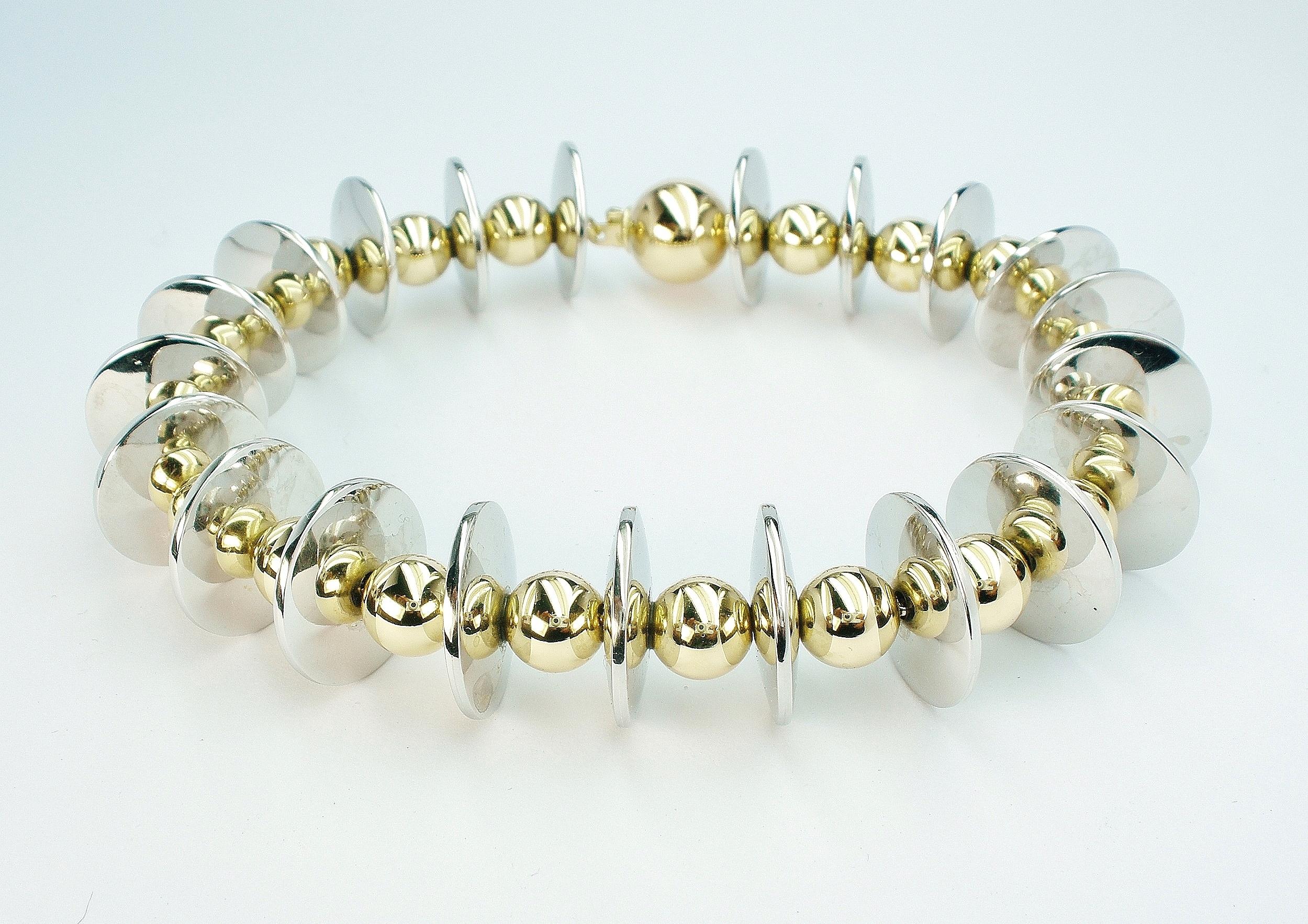 Handmade palladium disc & 18ct. yellow gold ball bracelet.