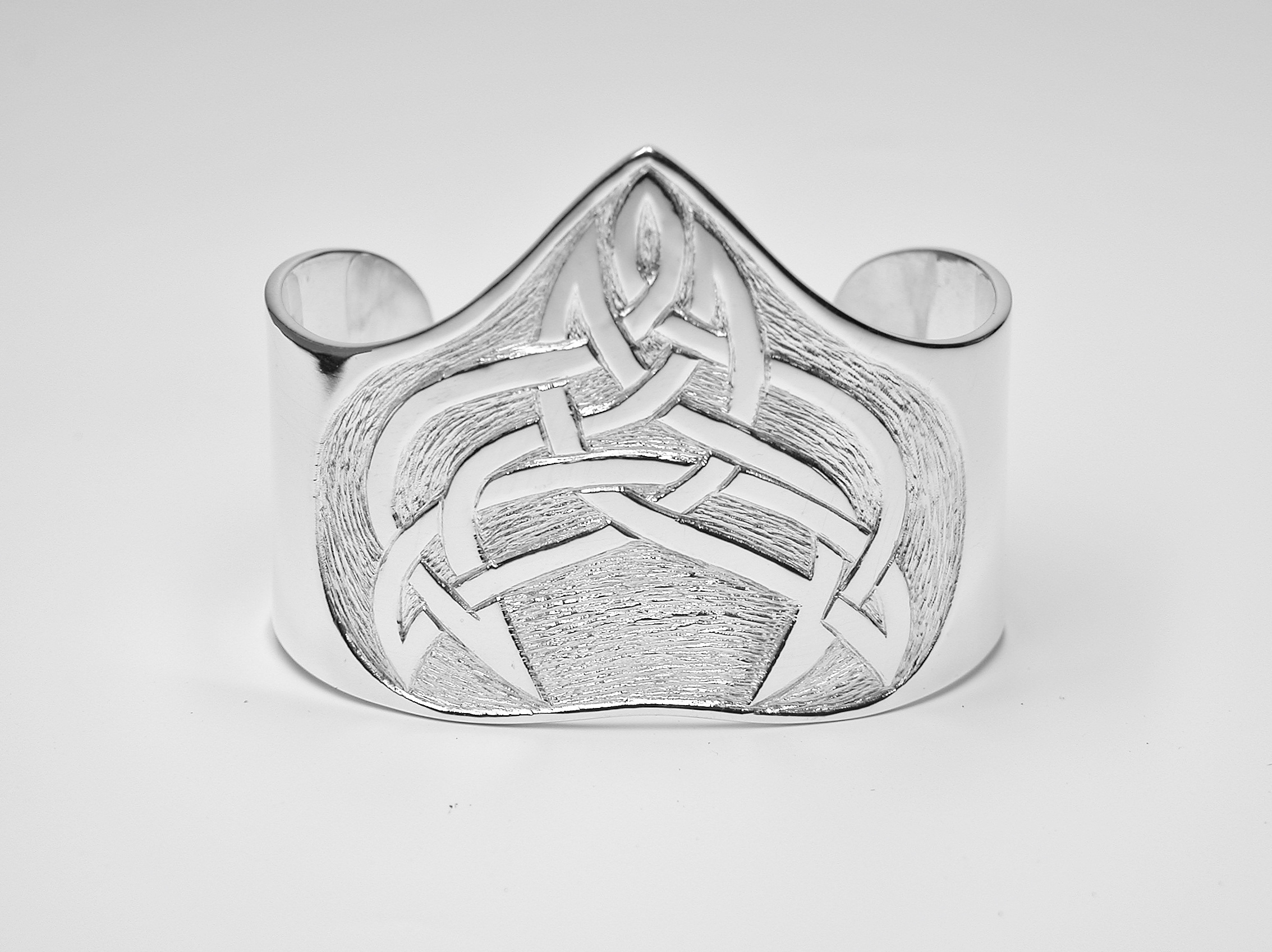 Sterling silver broad cuff torque bangle hand carved with an original Celtic designed pattern.