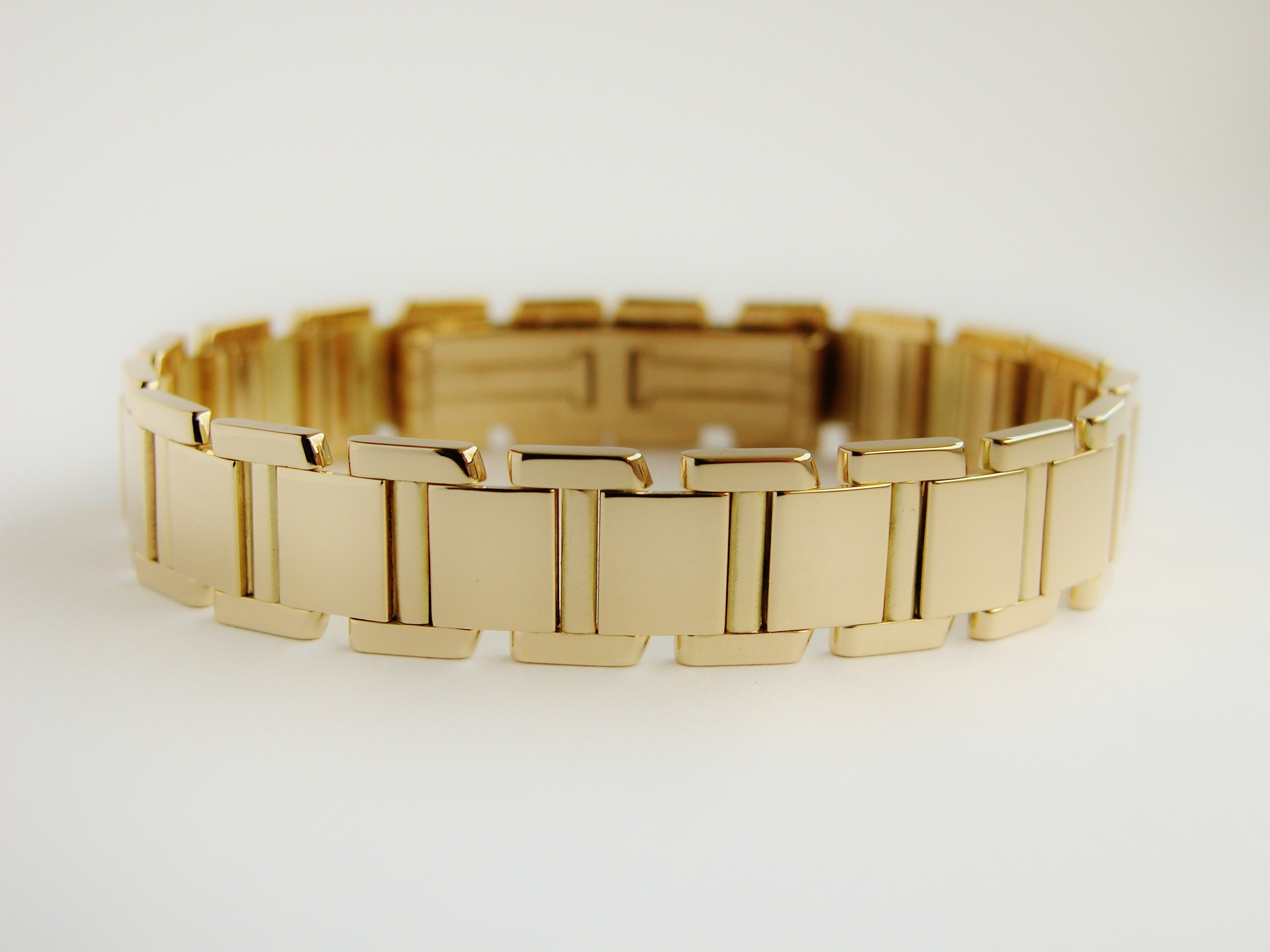 Handmade 18ct. yellow gold square panel bracelet with concealed clasp.
