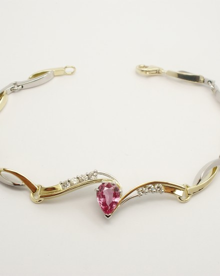 Pear shaped pink sapphire and diamond set 18ct. yellow gold and palladium bespoke bracelet.