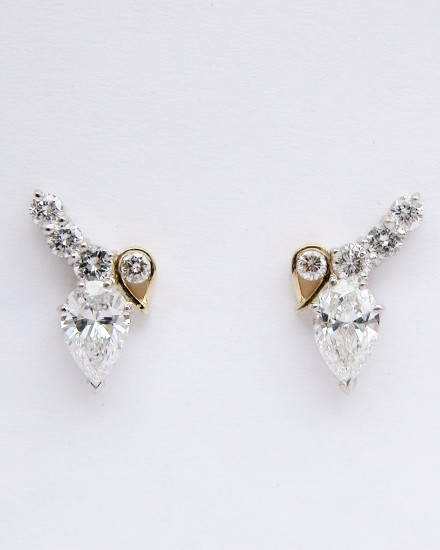 Platinum & 18ct. yellow gold pear shaped diamond &round brilliant cut diamond 5 stone stud earrings.