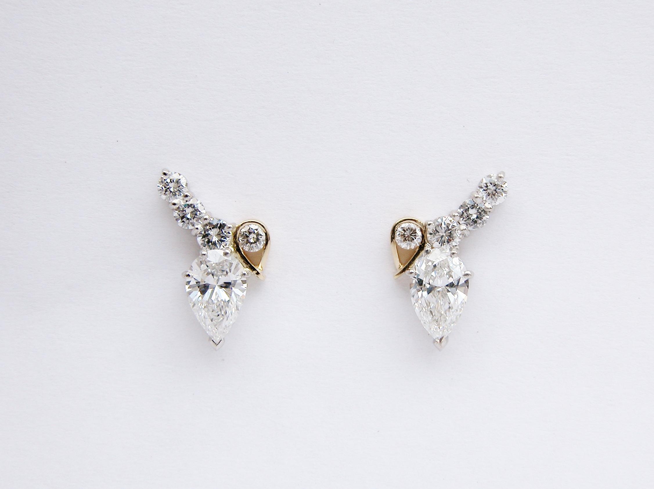 Platinum & 18ct. yellow gold pear shaped diamond &round brilliant cut diamond 5 stone stud earrings.