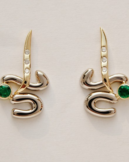 Round emeralds rub-over set in initial style 18ct.white & yellow gold earrings with small round brilliant cut diamonds flush set in the 18c. gold.