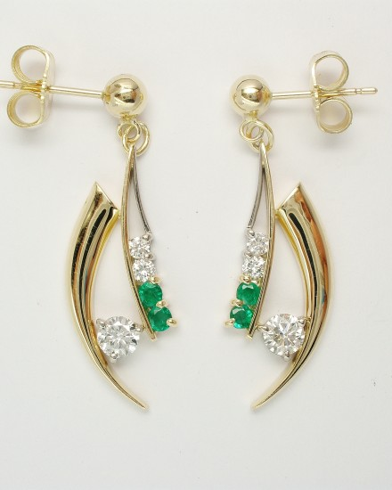 Pair of Horn shaped 9ct. yellow gold and palladium wire earrings set with diamonds & emeralds.