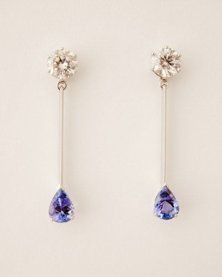 Pair of round brilliant cut Diamond stud earrings with a single pear shaped Tanzanite set at the bottom of a fine wire giving a pendulum effect.