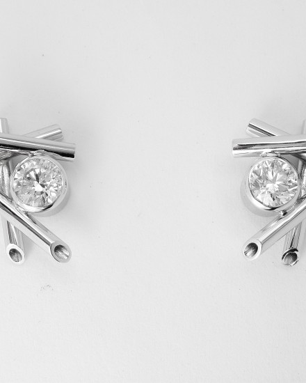 Single stone round brilliant cut diamond 'chop stick' style 18ct. white gold ear studs.
