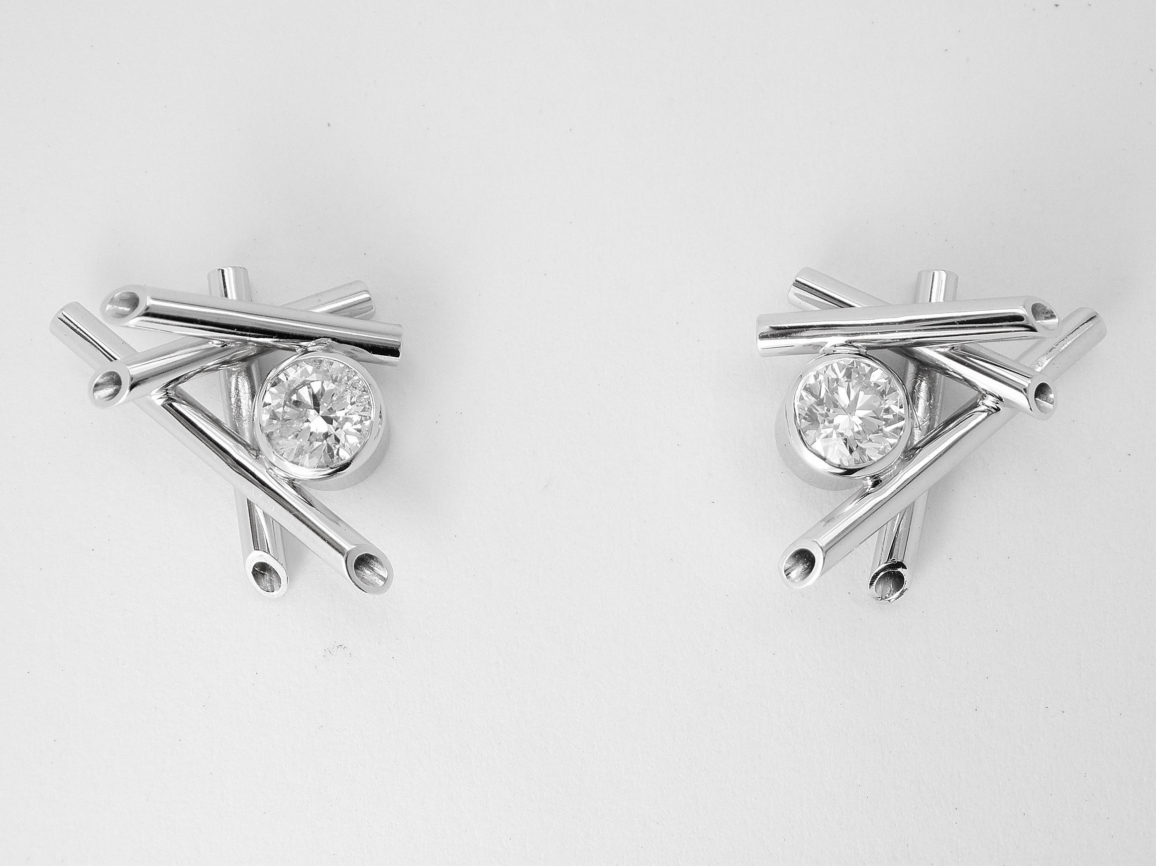 Single stone round brilliant cut diamond 'chop stick' style 18ct. white gold ear studs.