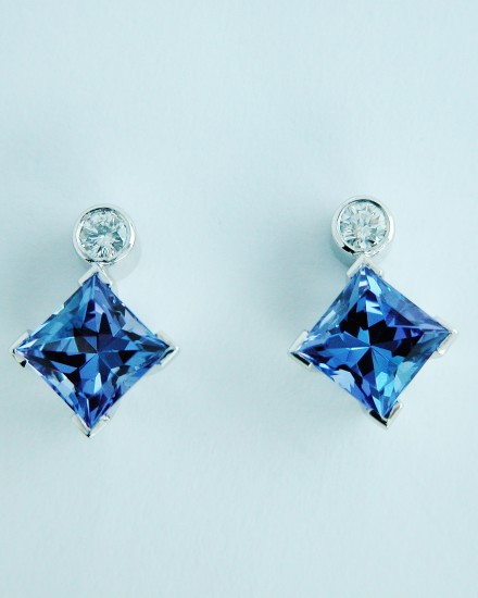 Princess cut tanzanite and brilliant cut diamond earring studs.